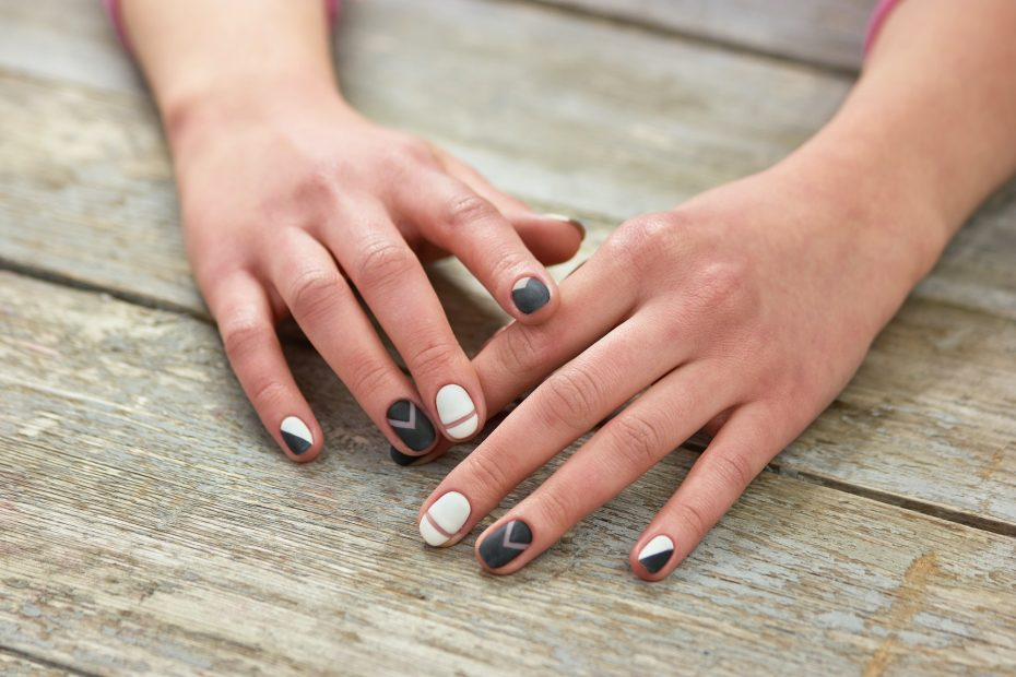 Woman hands with trendy manicure